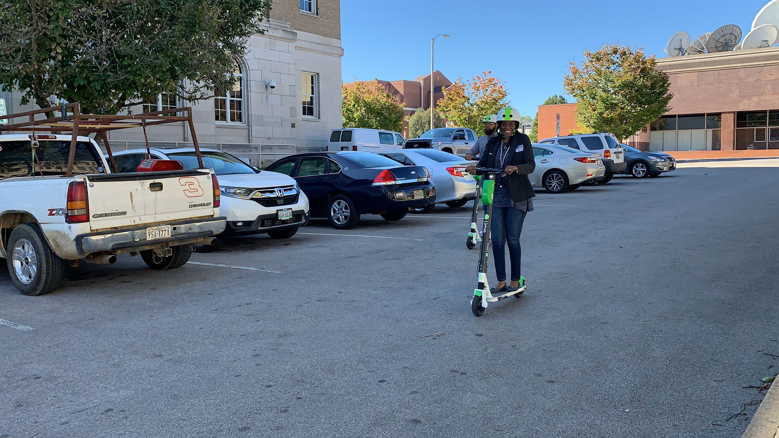 Riders prepare to demo new Lime Scooters in Downtown Roanoke.