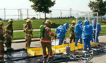Group of the HazMat team at the disinfectant area.